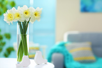 White narcissus in vase on the table indoors