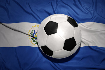 black and white football ball on the national flag of el salvador