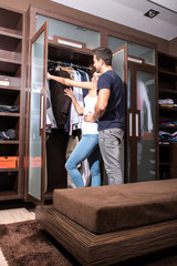 Beautiful young couple in the dressing room