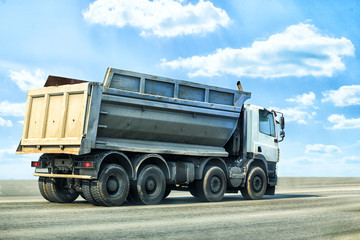 dump truck goes on highway