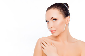 Beautiful woman expertising her skin after spa procedures