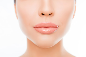 Close up photo of woman's face with perfect skin and lips