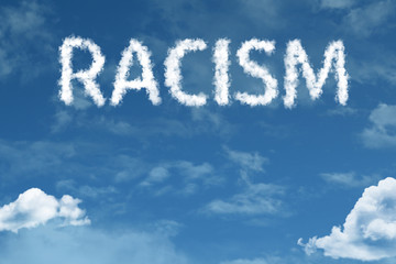 Racism cloud word with a blue sky