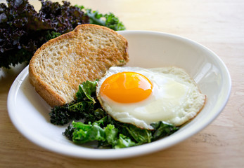 Local kale and a beautiful sunny side egg for a quick and easy weekday breakfast.