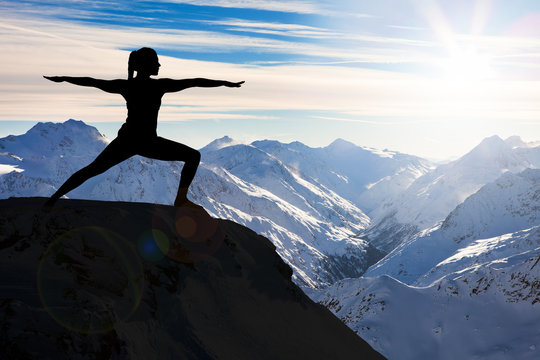 Woman Practicing Yoga On A Cliff