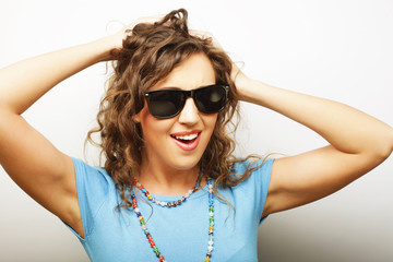 funny girl in sunglasses with expression of surprise