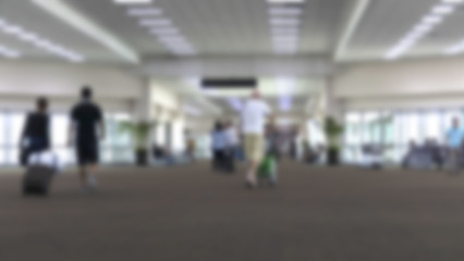 people in airport terminal, blur background