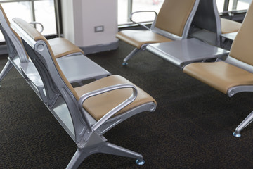 brown leather chair in airport terminal