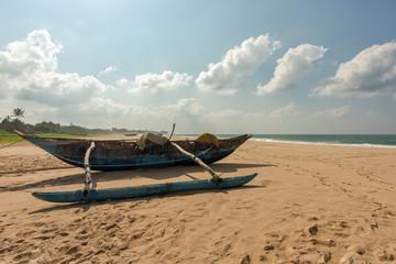Fishing boat on tropical beach in Sri Lanka