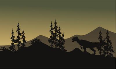 Silhouette of one allosaurus in hills