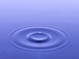 droplet on blue water
