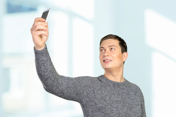 Happy young man taking a selfie photo