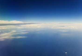 View of the atmosphere from the air. Clouds and blue sky. Wall mural