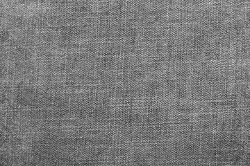 textured background from denim of pale gray color