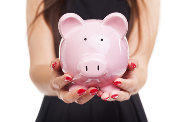 Woman hands holding a piggy bank on white background