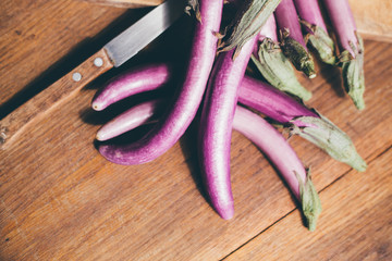 smart purple eggplants on the table , in kitchen, ready to be cooked