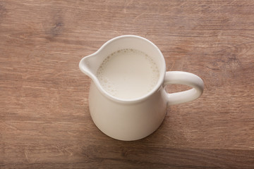 White pitcher with milk