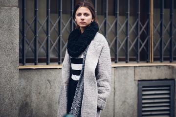 Modern wearing woman walking on the street