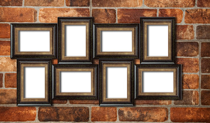 Eight picture photo frames on the red brick wall