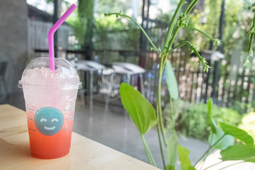strawberry soda in glass with smiling face