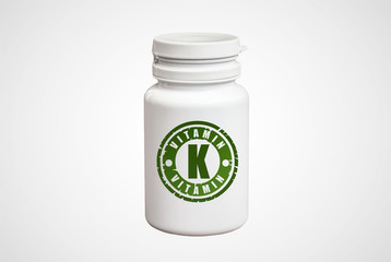 Bottle of pills with vitamin K