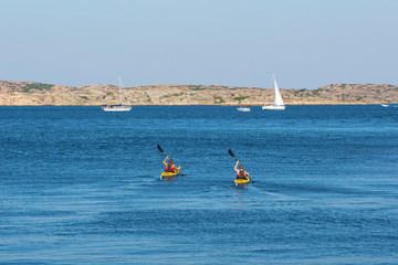 Kayakers on the sea