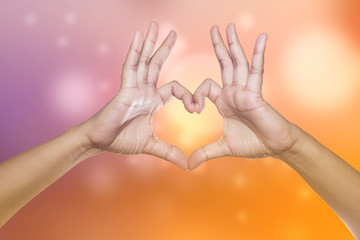 Healthy human hands in heart shape showing love