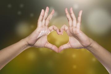 Healthy human hands in heart shape showing love