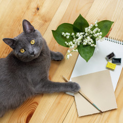 hobby idea and creativity/cat artist ready to paint with a brush bouquet
