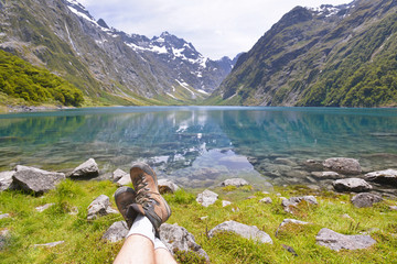 Resting with legs crossed, Lake Marian, New Zealand