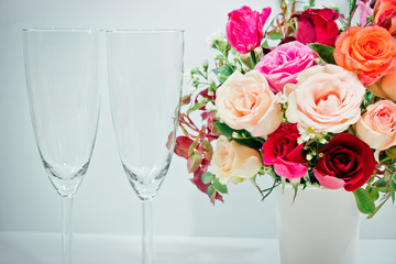 Vase of Roses bouquet and champagne glass