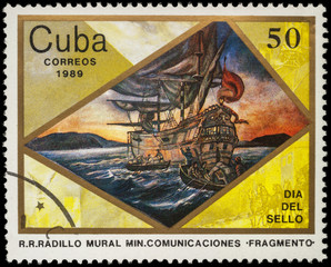 Sailing ship and boats with sailors on postage stamp