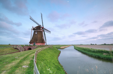 old Dutch windmill by canal