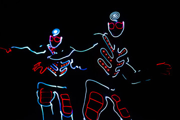 Fototapeten Ensemble dance team in costumes of the LEDs, light suits
