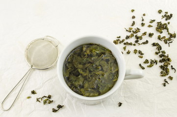 Green tea with jasmine leaf in a cup