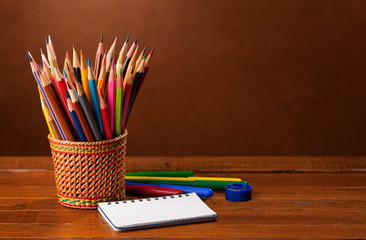 School equipment  on wood background.   Back to school concept.