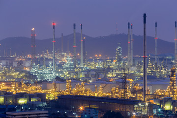Chemical refinery with mountain background night view