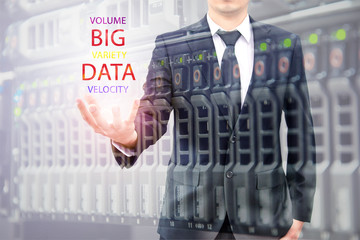 Double exposure of businessman holding big data information and