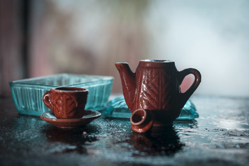 Antique Tea set and Glass mouth freshener Jar.isolated, selective focus, shallow depth of field, concept of memory.