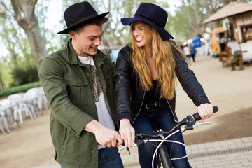Young stylish couple in love enjoying time together in the stree