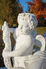 marble statue of angel in autumn park