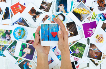 Set of polaroid photos in hands for good memories