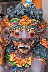 Dragon wooden sculpture on temple door in Bali, Indonesia