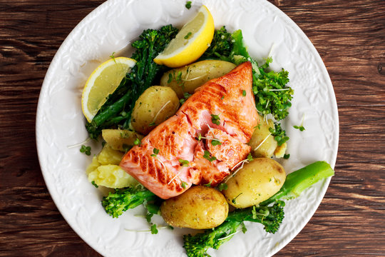 Pan fried Salmon Served with potatoes and tenderstem broccoli.