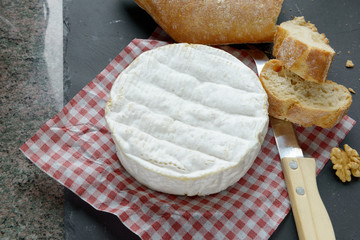Camembert on a red squares tablecloth