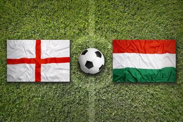 England vs. Hungary flags on soccer field