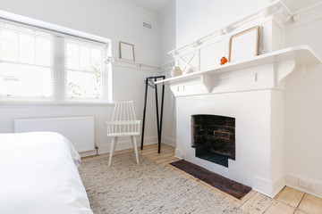 Feature fireplace in a luxury renovated Danish styled bedroom