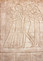 Old murals. Frieze of Egyptian Goddess. Wall carving