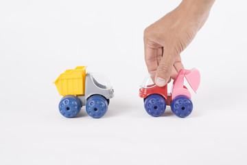 hand holding toys truck and excavators isolated