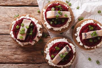 Norwegian sandwiches with herring, beetroot and cream cheese. Horizontal top view